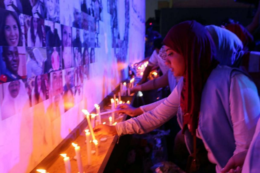 Egyptians light candles during a vigil for the victims of EgyptAir flight 804.