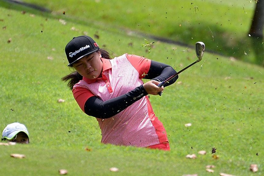 Inez Beatrice Wanamarta hitting an iron shot at the SLGA Amateur Open Championship. She mixed three birdies and a bogey in her final round.
