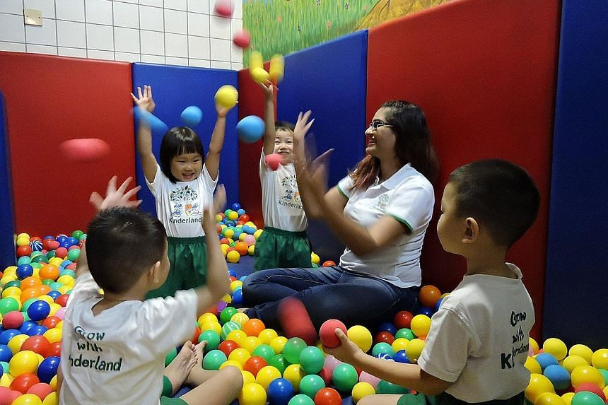Kinderland @ Ministry of Manpower teacher Komalgeet Kaur Sandhu playing with some of her pupils. The pre-school was one of the centres that participated in the NTU psychology study in 2013.