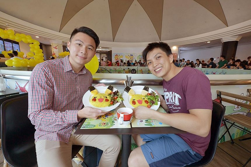 Mr Eugene Liew and Mr John Chow (both left) were in line at 6am yesterday for the opening of the cafe.