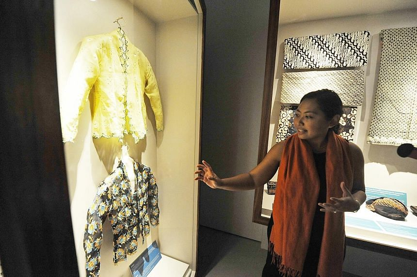 Malay Heritage Centre curator Suhaili Osman with hand-embroided kebaya blouses, which are among the more than 35 items on display.