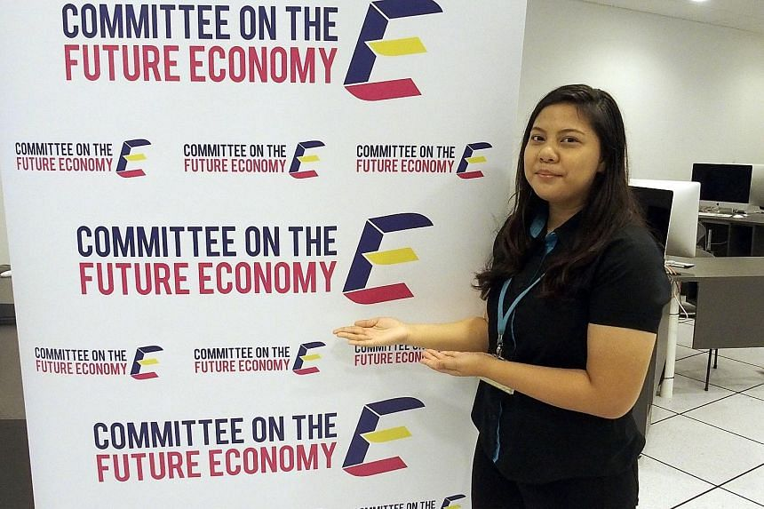 """Ms Hazirah said of her logo: """"The letter E is made to look like a ladder. This portrays the idea of achieving future excellence and goals at every step we take. It is in 3-D because I feel we have to look at things from different angles."""""""