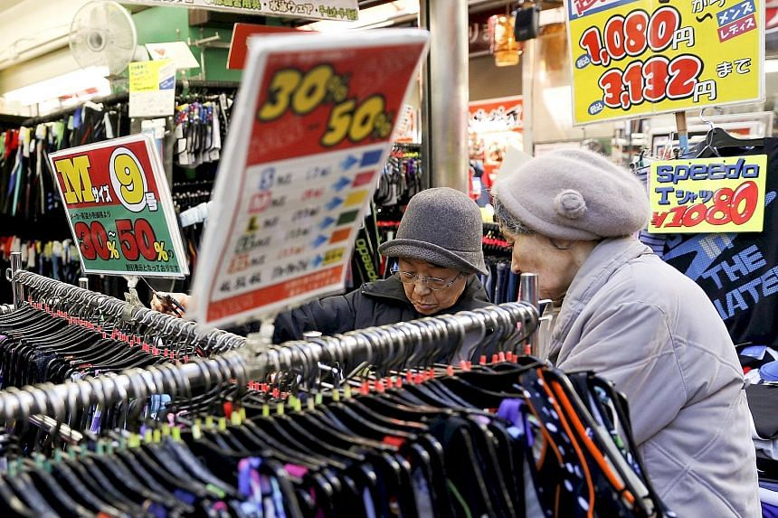 Swimsuits on sale at a store in Ameyoko shopping district in Tokyo in January. Some analysts have warned that Japan may be returning to deflation despite PM Abe's stimulus measures to halt sustained price declines.