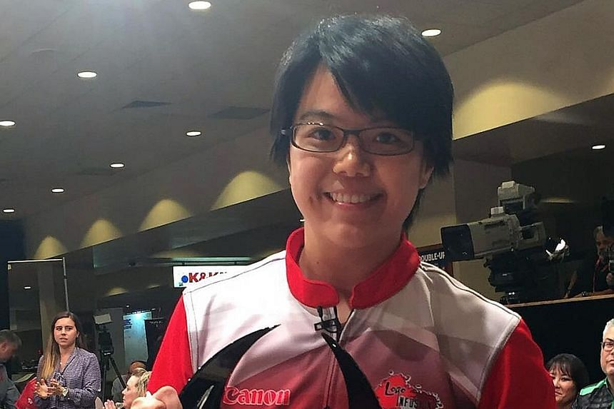 Singapore bowler Bernice Lim (left) showing her biggest individual trophy after beating top seed Sandra Andersson to claim the USBC Queens title, a major event on the PWBA tour. Team-mate Cherie Tan (right) was also victorious on Thursday, winning th