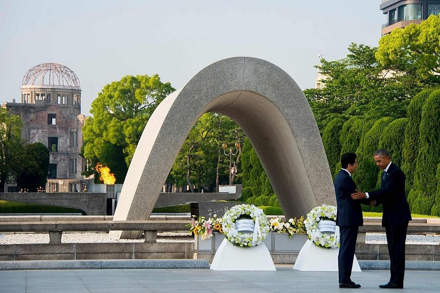 US President Obama hugging a survivor of the 1945 atomic bombing of Hiroshima in an emotional moment during a visit to the Hiroshima Peace Memorial Park yesterday. He is the first sitting American president to make the trip. Mr Obama with Japanese Pr