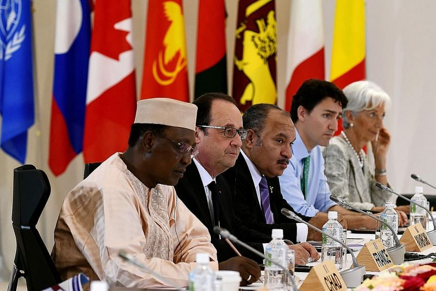 At the Outreach Session of the 2016 Ise-Shima G-7 summit in the city of Shima in Japan yesterday were (from left) Chad's President Idriss Deby, French President Francois Hollande, Papua New Guinea's Prime Minister Peter O'Neill, Canadian Prime Minist