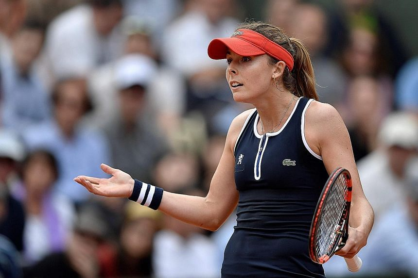 Alize Cornet (above) was accused by Tatjana Maria of faking an injury.