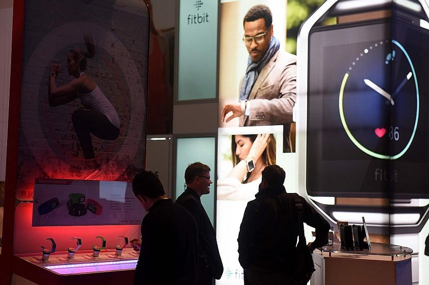 Fitbit products on display at an electronics show in Las Vegas. The company is being accused of misleading customers about the reliability of the PurePulse technology in its heart-monitoring wristbands.