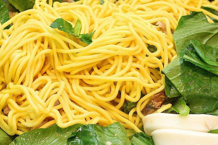 Lye is added to yellow noodles to prevent them from disintegrating when cooked in soup.