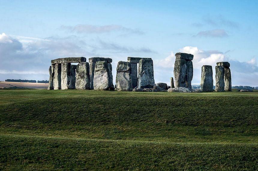 Stonehenge (above) in England and Australia's Great Barrier Reef (below) are among the world's heritage sites that are already feeling the impact of climate change, say scientists. All references to Australia were cut from the report after objections