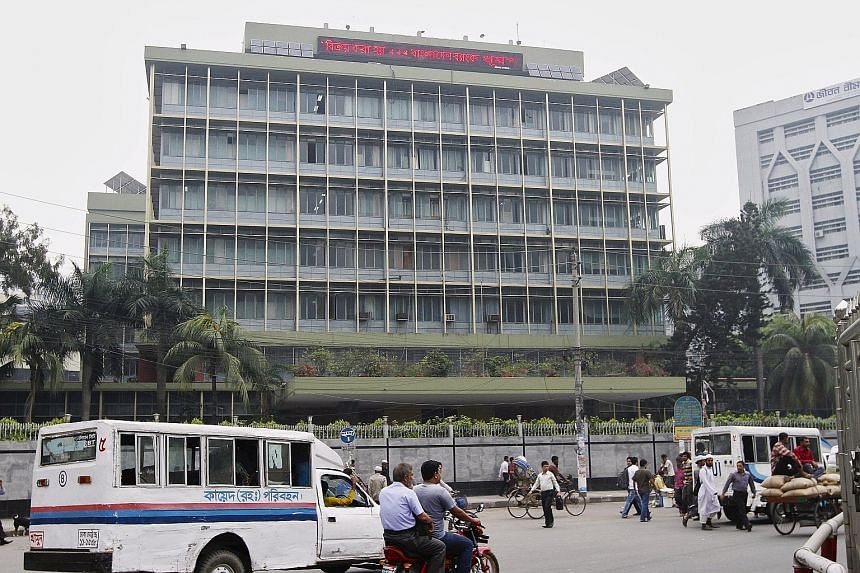 The Bangladesh central bank building in Dhaka. The irregularities found in the 12 banks were similar to those involving the theft of US$81 million (S$111.5 million) earlier this year from the Bangladesh central bank.