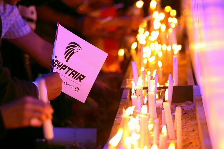 People lighting candles during a vigil for the victims of EgyptAir flight 804 at the Cairo Opera house on May 26.