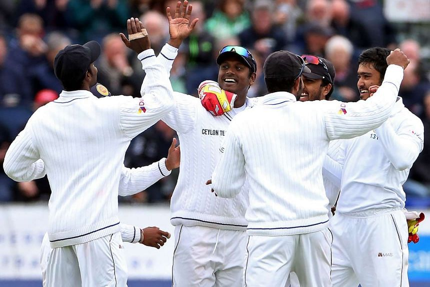 Sri Lanka's captain Angelo Mathews (centre) celebrating after taking the wicket of England's Alex Hales.