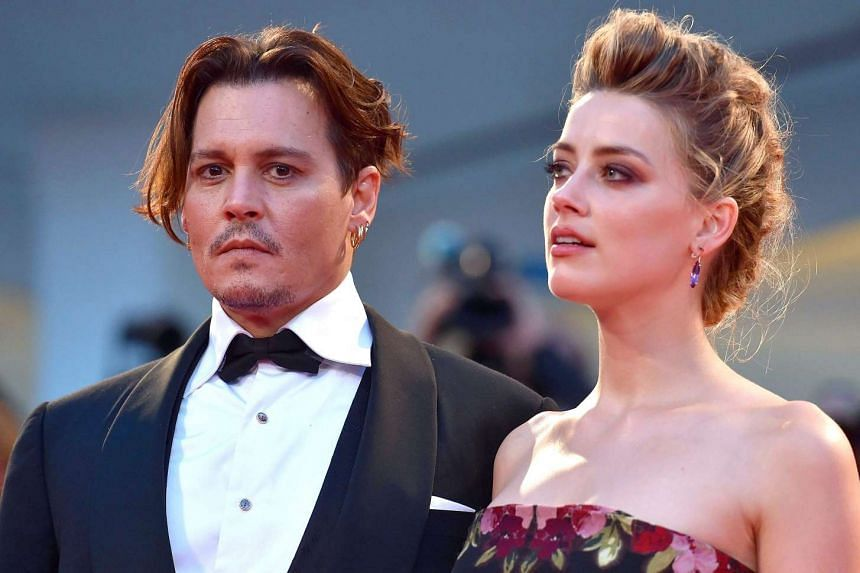 Amber Heard and Johnny Depp arriving for the premiere of The Danish Girl at the Venice International Film Festival in 2015.