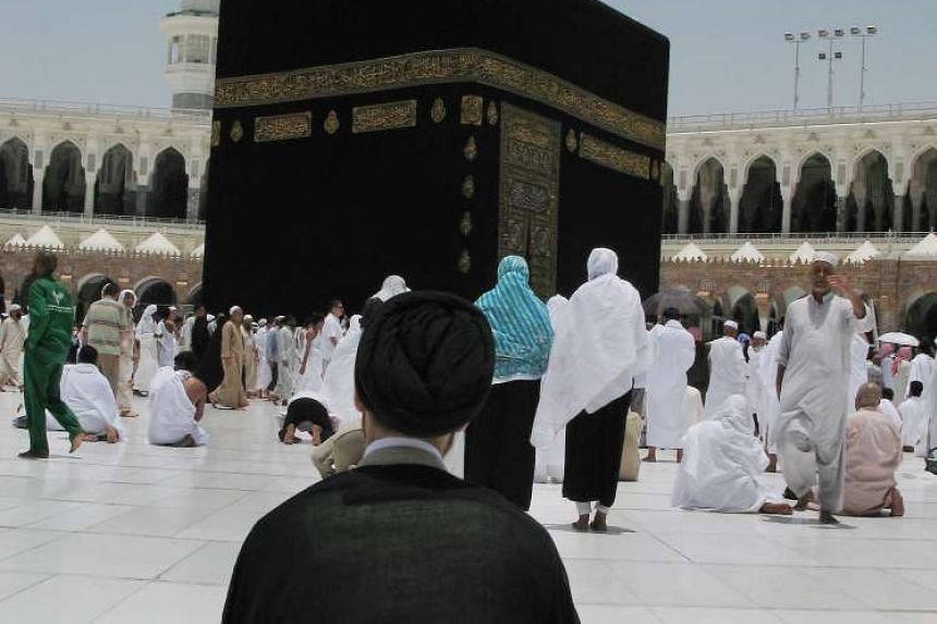 An Iranian Shi'ite Muslim pilgrim prays in front of the Kaaba inside Mecca's Grand Mosque in 2008.