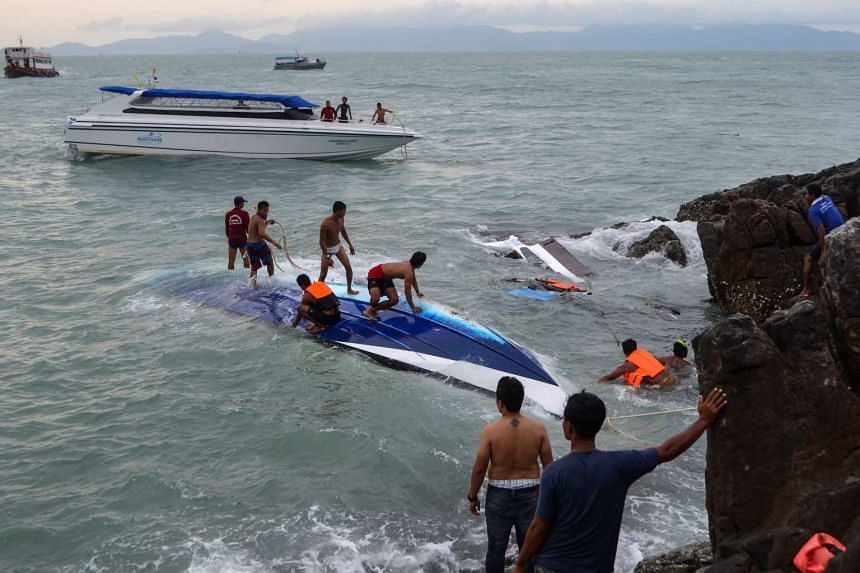 Rescue workers search for victims after a speedboat crashed and capsized in bad weather near the Koh Samui, Thailand, on May 26, 2016.