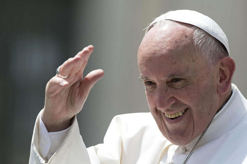 Pope Francis waving to the crowd at St Peter's Square on May 25.