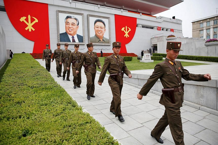 Soldiers walking under pictures of former North Korean leaders Kim Il Sung and Kim Jong Il at Pyongyang's main ceremonial square on May 10.