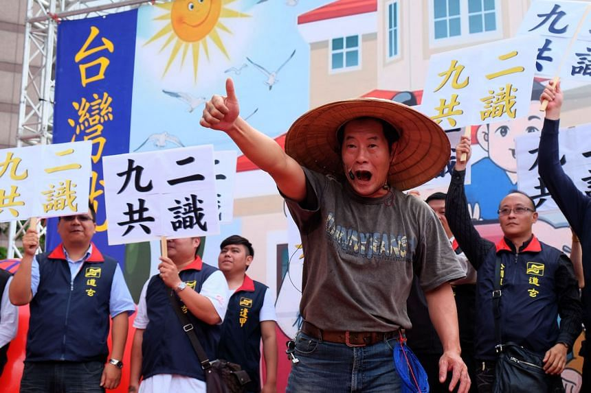 """Pro-unification activists holding placards that read """"92 consensus"""" during a protest outside the DPP headquarters in Taipei earlier this month. Ms Tsai's ambiguous stance on the 1992 consensus has prompted criticism from pro-independence forces, but incre"""