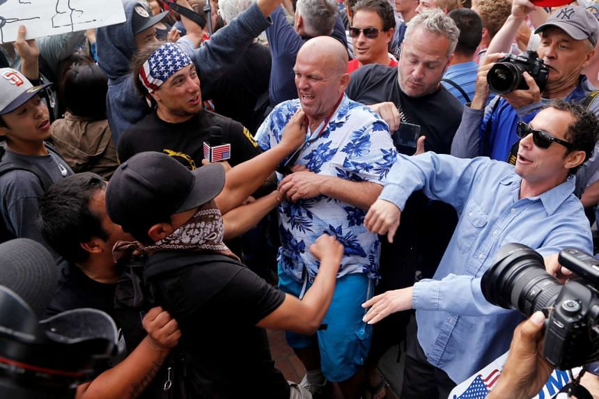 Trump supporters and anti-Trump demonstrators clash outside a campaign event for the US presidential candidate in San Diego on May 27.