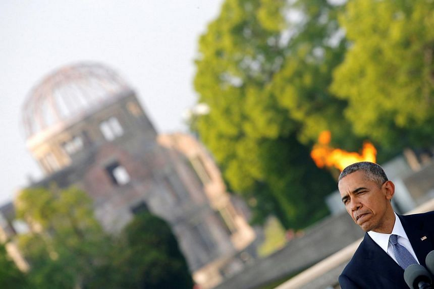 US President Barack Obama and Japanese Prime Minister Shinzo Abe (not pictured) attending a ceremony at the Peace Memorial Park in Hiroshima on May 27.