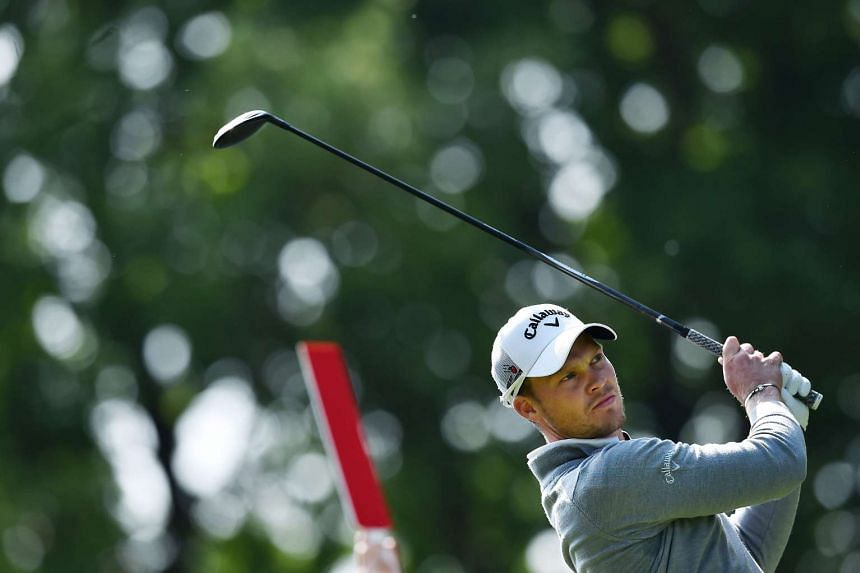 Willett plays his tee shot on the 9th hole on the second day of the PGA Championship at Wentworth