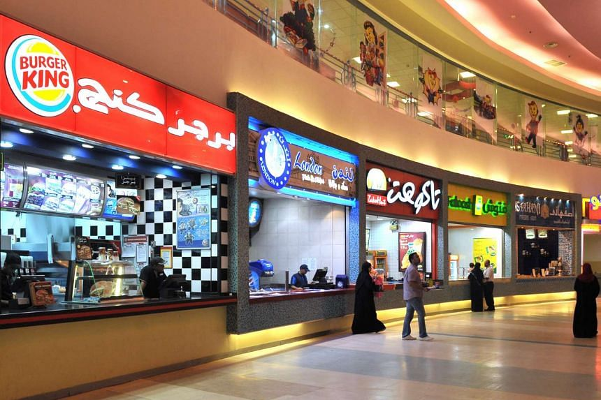 Fast food outlets in the Mall of Dhahran in Dhahran, Saudi Arabia. Kuwait's fast-food group Americana owns the Middle East franchises for fast food chains KFC and Pizza Hut.