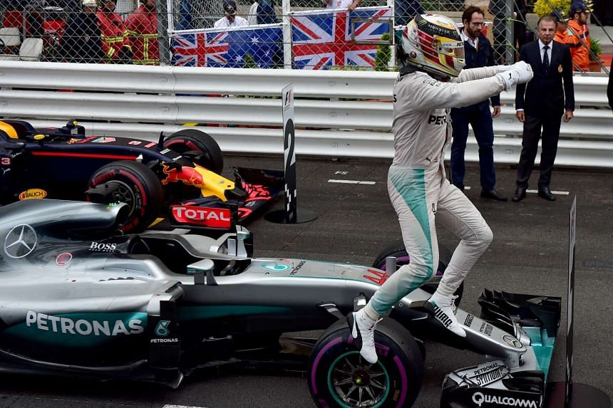 Lewis Hamilton celebrates in the parc ferme at the Monaco street circuit on May 29, 2016 in Monaco, after the Monaco Formula 1 Grand Prix.