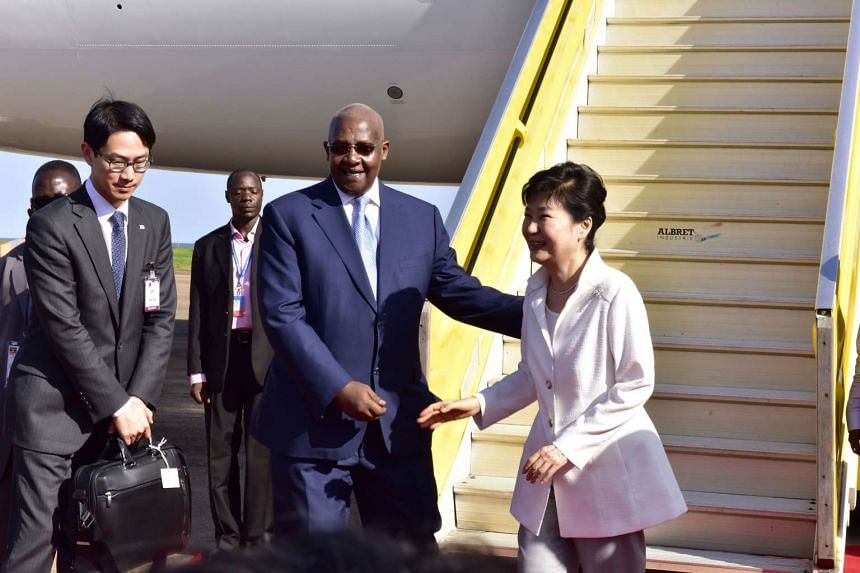 Foreign Affairs Minister Sam Kutesa (centre) receiving South Korean President Park Geun Hye (right) at Entebbe International Airport, on May 28, 2016.