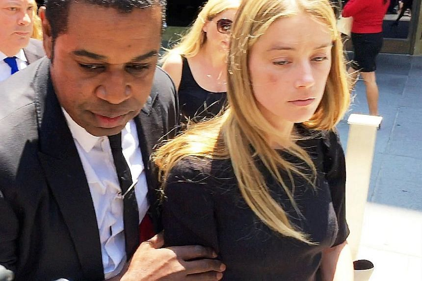 Amber Heard leaving court with a black eye after getting a restraining order against Johnny Depp (left).