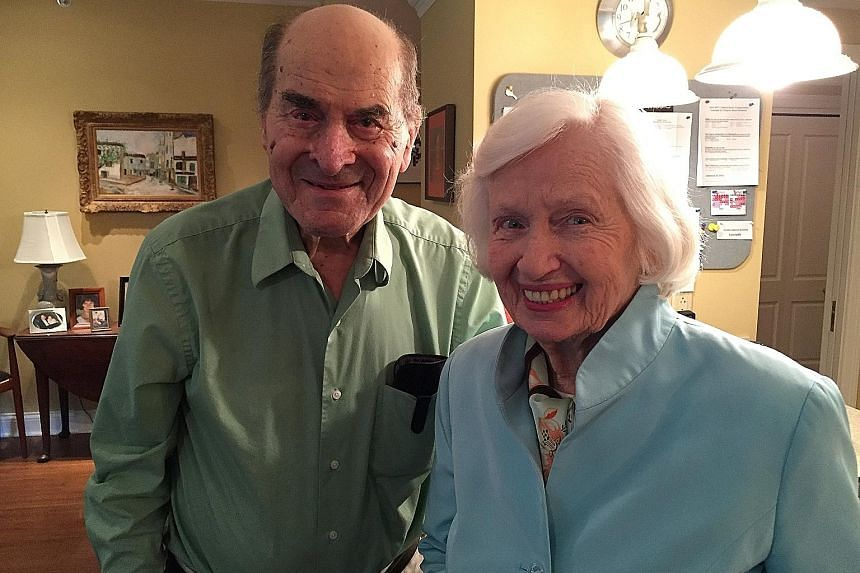 Dr Henry Heimlich with Madam Patty Ris, 87, the woman he saved with his manoeuvre after she choked on food. She was having her meal at the same table as Dr Heimlich at a senior centre in Cincinnati.