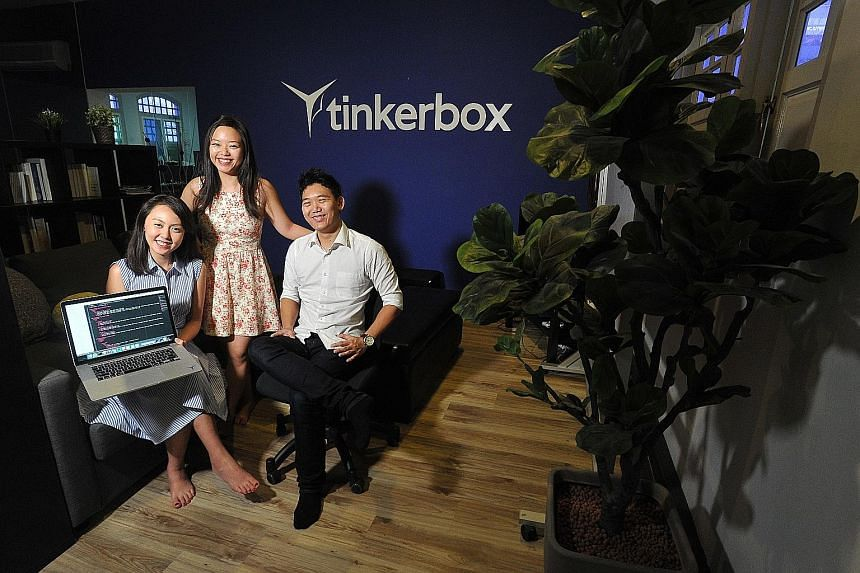 Ms Elisha Tan (standing), founder of TechLadies, says it is a shame women are put off by programming because they think that it is a male- dominated field. She is seen here with Mr Jaryl Sim, founder of Tinkerbox, and Ms Kate Lim, a Tinkerbox intern.
