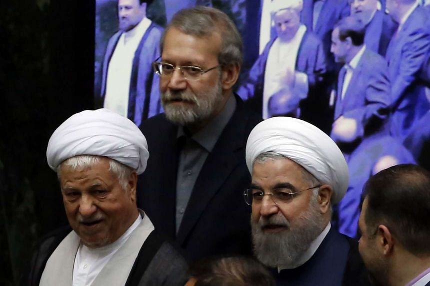 Iranian former president Ayatollah Akbar Hashemi Rafsanjani (left), Parliament Speaker Ali Larijani (centre) and President Hasan Rouhani attend the opening session of the new parliament in Teheran on May 28, 2016.