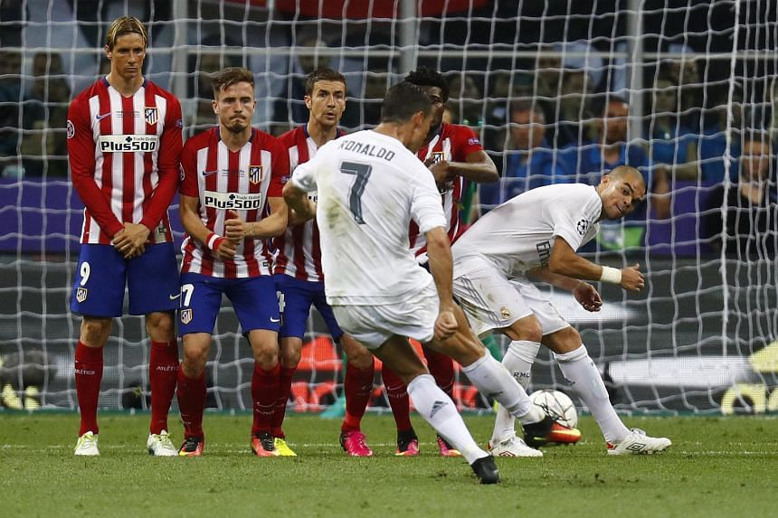 Real Madrid's Cristiano Ronaldo shoots at goal from a free kick.