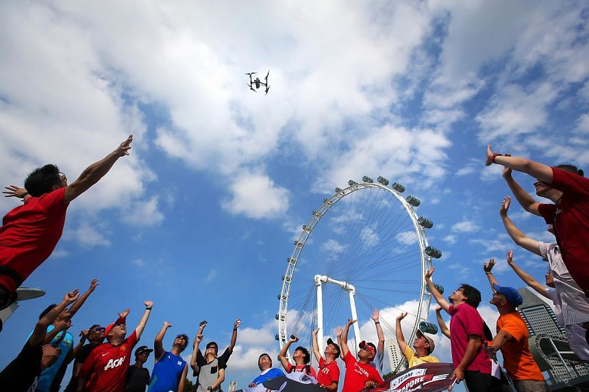 Drone enthusiasts taking part in International Drone Day at the Singapore Flyer on March 14, 2015.