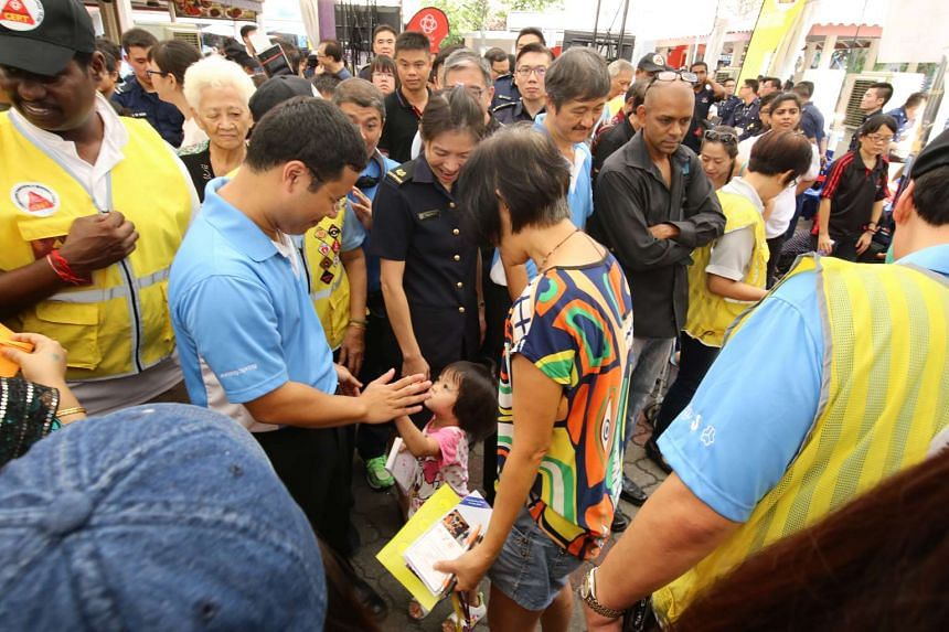 Senior Minister of State Desmond Lee mingling with members of public at the Emergency Preparedness Day event on May 29, 2016.