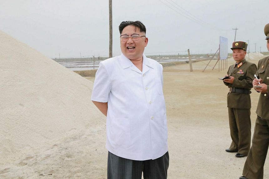 North Korean leader Kim Jong Un visits the Kwisong Saltern to learn about the salt production.