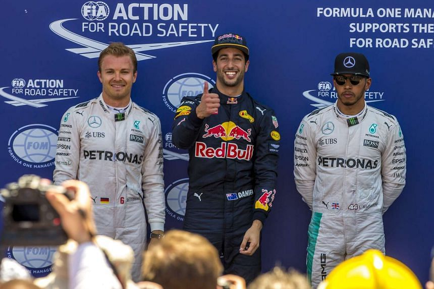 Third-on-the-grid Hamilton is pictured in Monaco (right) after Daniel Ricciardo took pole, with Nico Rosberg second.