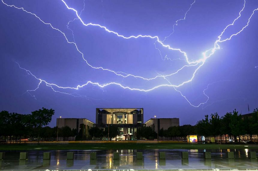 Lightning strikes over the German Chancellery in Berlin, Germany, May 23, 2016.