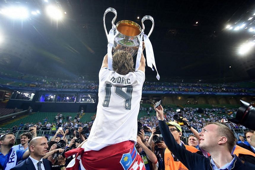 Luca Modric celebrates with the trophy after their win in the Uefa Champions League Final between Real Madrid and Atletico Madrid.