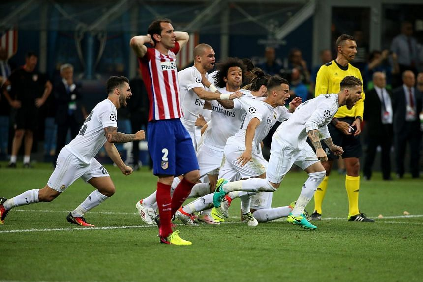 Real Madrid players react after winning the penalty shootout of the Uefa Champions League Final.