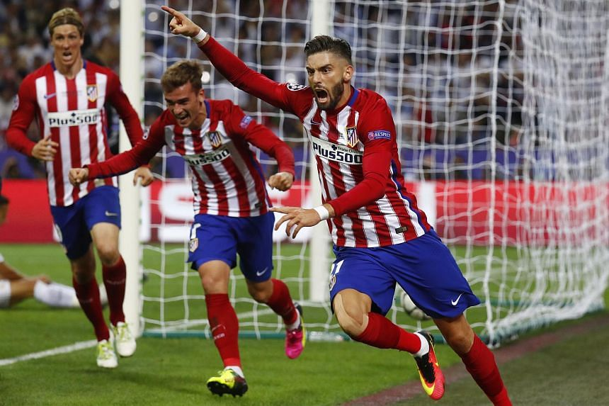 Yannick Ferreira Carrasco celebrates with Antoine Griezmann (centre) and Fernando Torres (left) after scoring the first goal for Atletico Madrid.