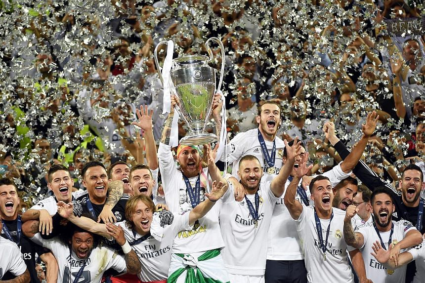 Real Madrid's Sergio Ramos lifts the trophy after winning the Uefa Champions League.