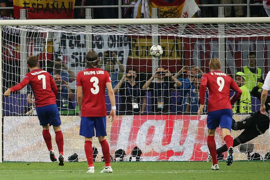 Atletico Madrid's Antoine Griezmann hits the crossbar with a penalty.