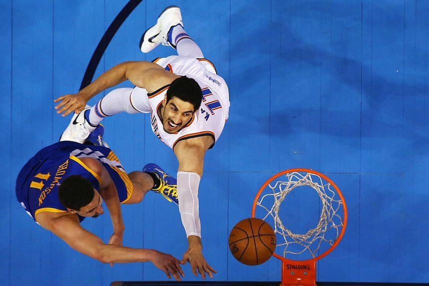 Golden State Warriors' Klay Thompson (left) shoots the ball in the first half of Game 6 against Oklahoma City Thunder's Enes Kanter.