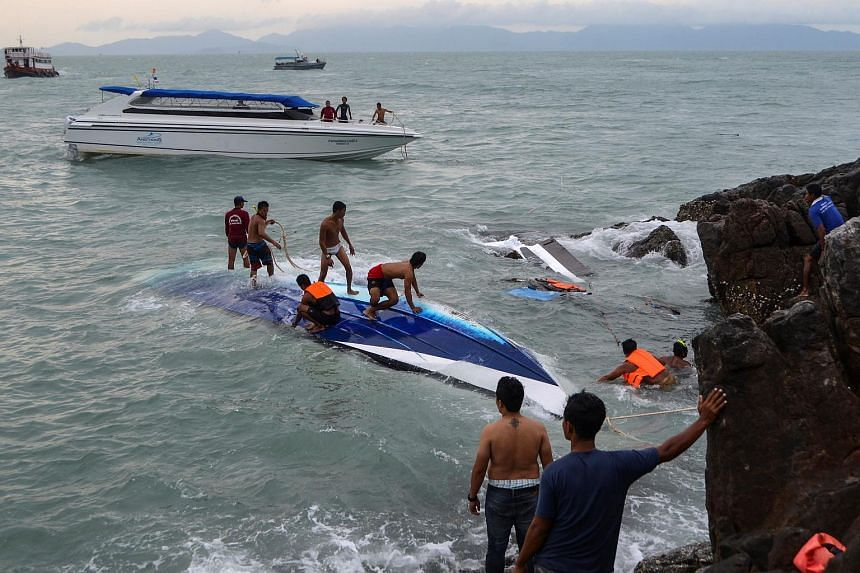 Rescue workers search for victims after a speedboat crashed and capsized in bad weather in southern Thailand on May 26.