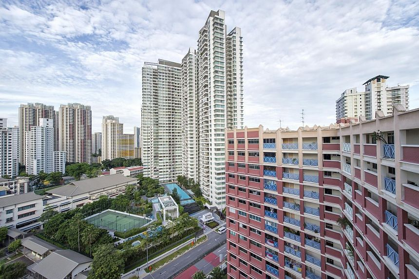 A private residential complex stands among public housing buildings in Toa Payoh.