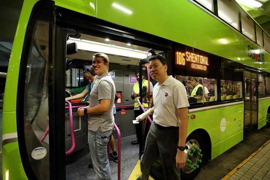 Tower Transit Singapore MD Andrew Bujtor and National Transport Workers' Union's executive secretary Melvin Yong board the first bus leaving Batok Batok Bus Interchange to Clementi Bus Interchange.