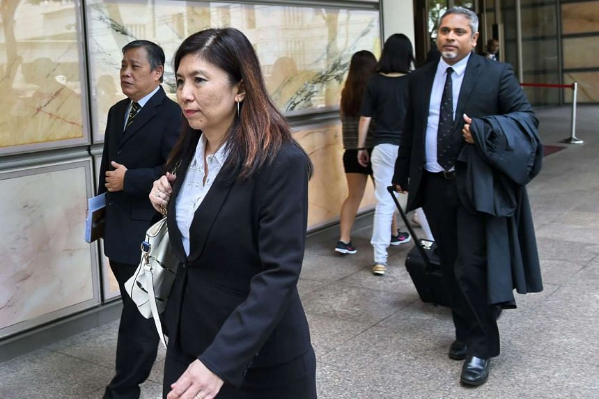 Defence lawyers Jeannette Chong-Aruldoss (front) and Alfred Dodwell (right) for Malaysian murder convict Kho Jabing leave the Supreme court on May 20, 2016.