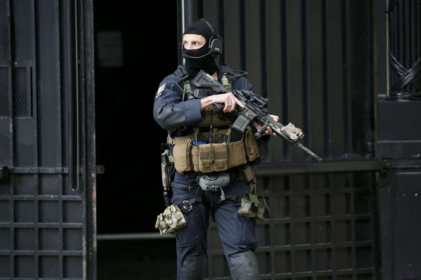 A special forces member outside the courthouse during the departure of Paris attacks suspect Salah Abdeslam after his first hearing, on May 20, 2016.
